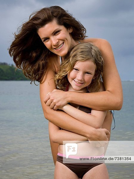 Portrait of a mother hugging her daughter