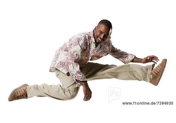 African American man jumping