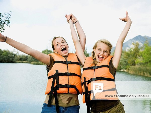 two girls in life vests