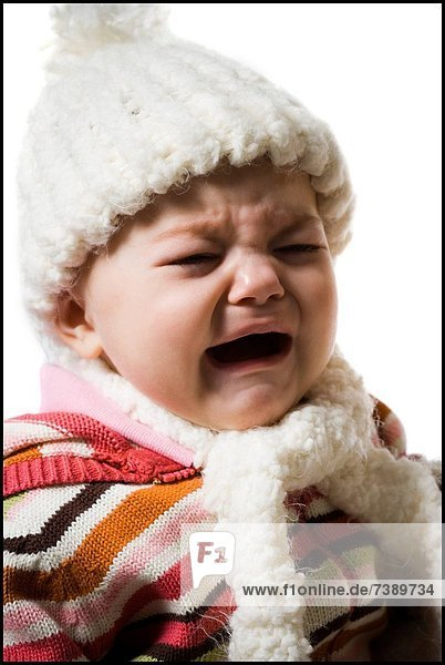 Baby Girl in toque and scarf crying