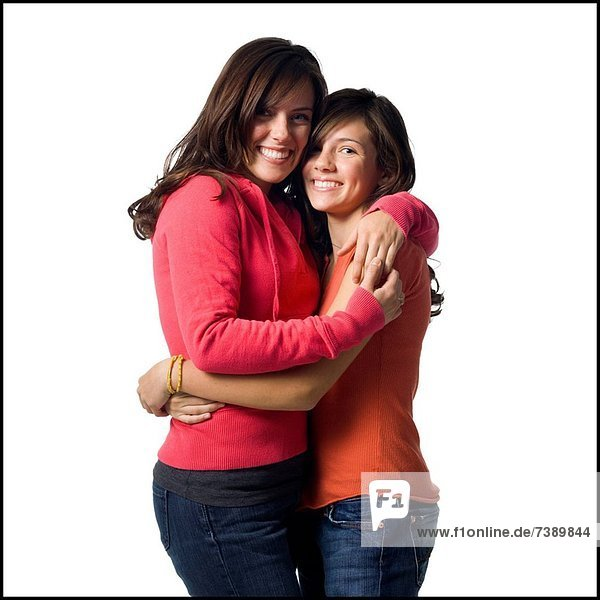 Woman and girl embracing