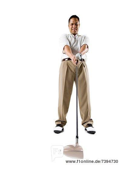Golfer swingenden club