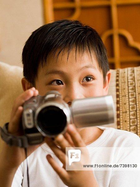 lächeln  Junge - Person  Camcorder