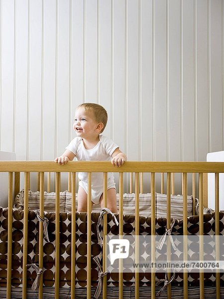 USA  Utah  Provo  Baby boy 18_23 months standing in crib