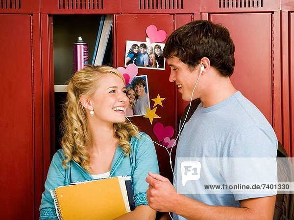 Teenage couple at school.