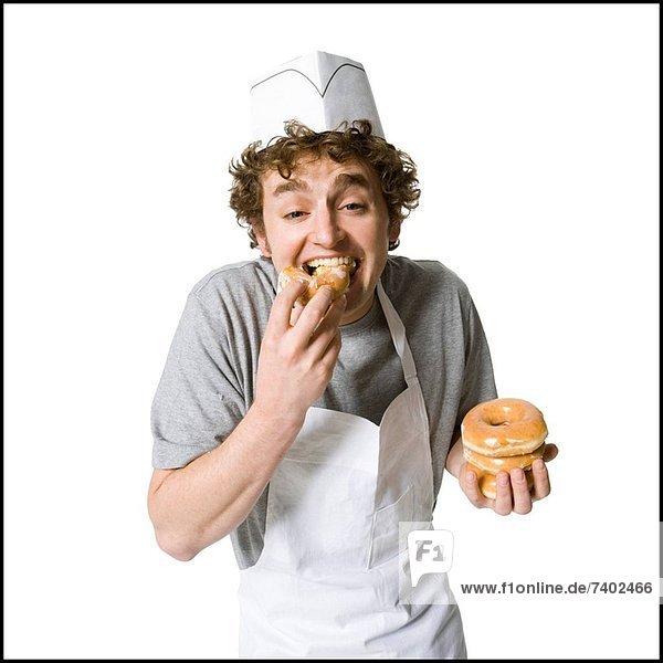 Koch  Donut  essen  essend  isst