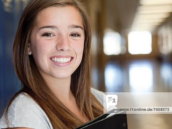 USA  Utah  Spanish Fork  Portrait of school girl 16_17 holding file in corridor