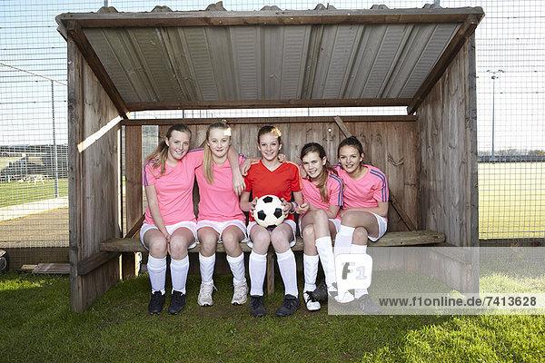 Football team sitting together