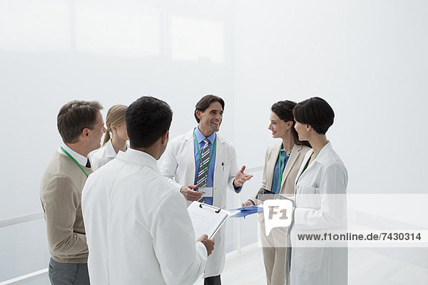 Smiling doctors discussing medical charts