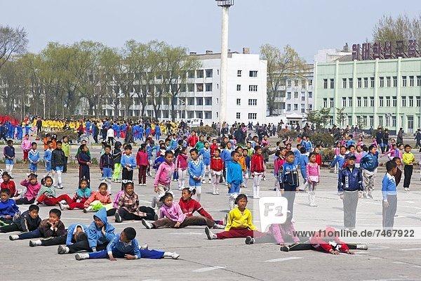 Children practising mass games outside the Grand Theatre  Hamhung  Democratic People's Republic of Korea (DPRK)  North Korea  Asia
