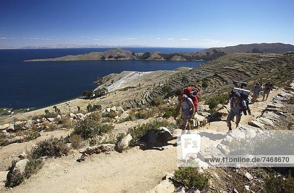 Insel  wandern  Titicacasee  Backpacker  Bolivien  Südamerika  Sonne