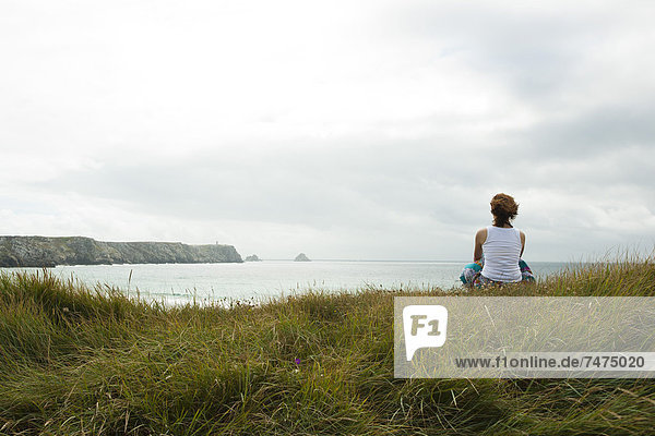 Woman Sitting and Looking into the Distance at the Beach  Camaret-sur-Mer  Crozon Peninsula  Finistere  Brittany  France