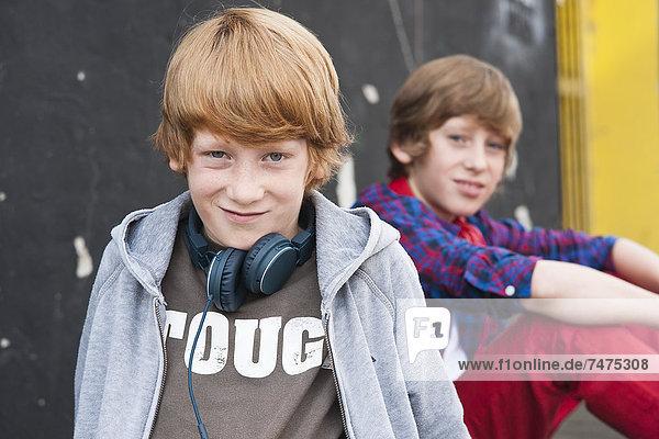 Boys wearing Headphones Outdoors  Mannheim  Baden-Wurttemberg  Germany