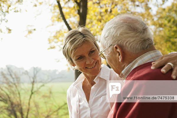 Mature Woman with Senior Father in Autumn  Lampertheim  Hesse  Germany