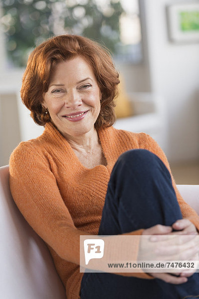 Portrait of senior woman relaxing on sofa
