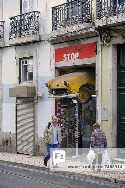 Souvenir shop selling curiosities in the historic district  has a radiator of a car hanging above the entrance  Chiado district  Lisbon  Portugal  Europe