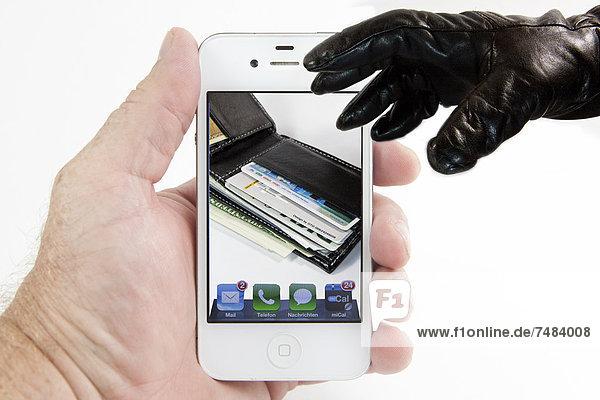 Hand mit Handschuh greift nach Portemonnaie auf Smartphone-Display  Symbolbild Diebstahl von sensiblen Daten vom Handy