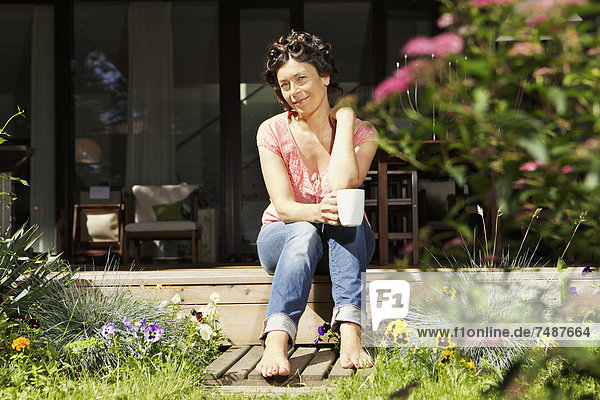 Mature woman relaxing on terrace