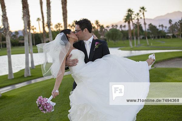 Hochzeit  küssen  Golfsport  Golf  Kurs