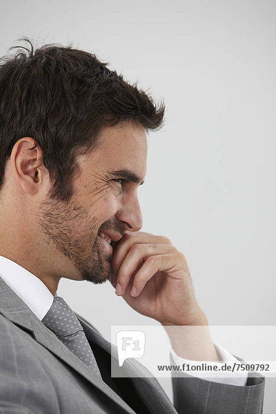 Happy businessman profile