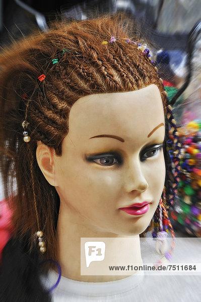 Head of a fashion doll with braids  Eichstaett  Bavaria  Germany  Europe