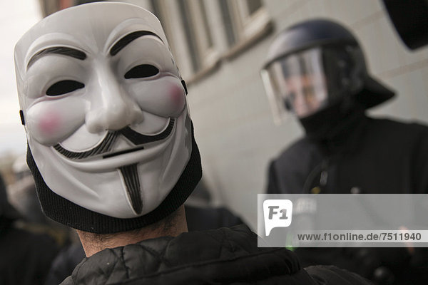 Man wearing a Guy Fawkes mask during a protest against capitalism in Frankfurt  Hesse  Germany  Europe
