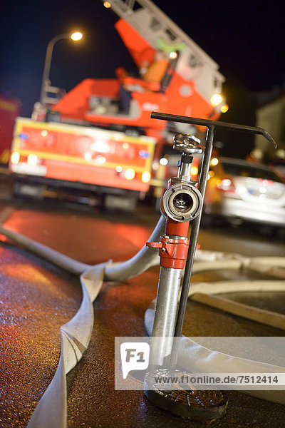Standpipe on an underground hydrant  a turntable ladder truck of the Backnang volunteer fire department at the back  Stuttgart  Baden-Wuerttemberg  Germany  Europe
