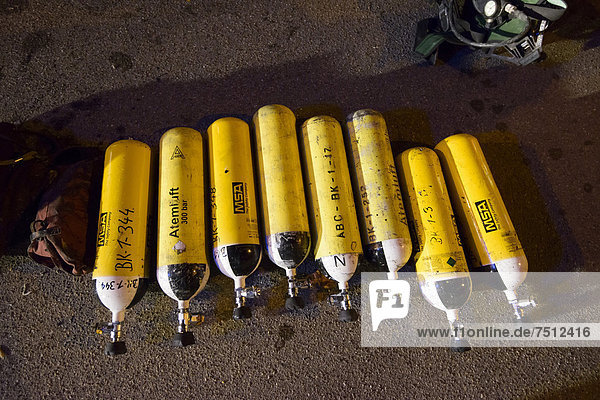 Oxygen tanks for the compressed air breathing apparatuses  respiratory protective equipment of the fire department  Stuttgart  Baden-Wuerttemberg  Germany  Europe