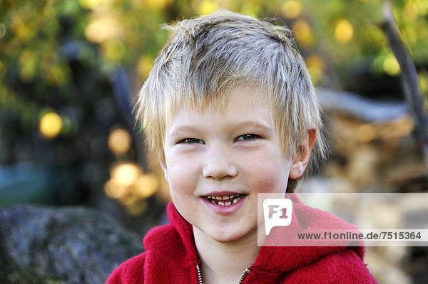 Portrait of a blond boy smiling  five years old  Othenstorf  Mecklenburg-Western Pomerania  Germany  Europe