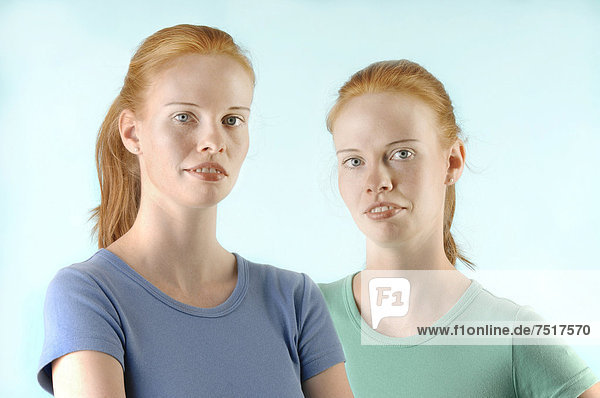 Young red-haired twin sisters  portrait