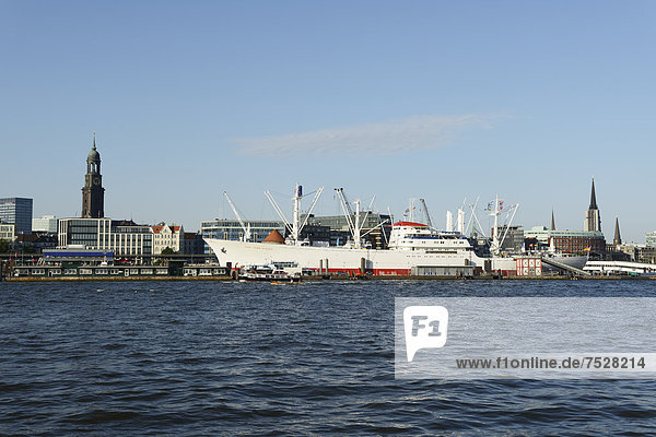 '''Cap San Diego'' museum ship  St. Michaelis church  colloquially called ''Michel'' at back  Port of Hamburg'