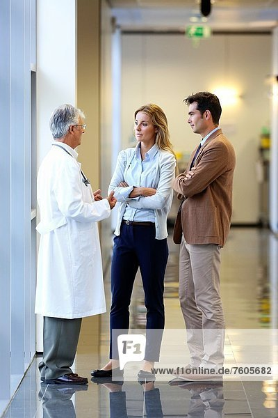 Doctor talking with the patient´s family in the hospital corridor  Onkologikoa Hospital  Oncology Institute  Case Center for prevention  diagnosis and treatment of cancer  Donostia  San Sebastian  Gipuzkoa  Basque Country  Spain
