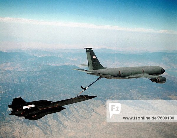 NASA Dryden Flight Research Center's SR_71B  tail number 831  is seen here receiving air refueling from a USAF tanker during a July  1995 flight.