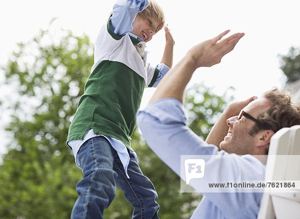 Father and son high fiving outdoors