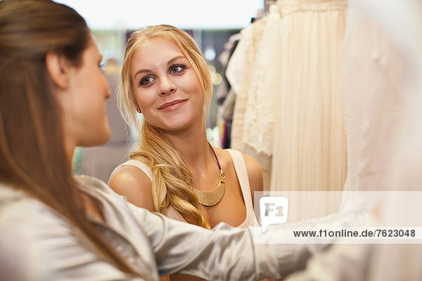 Women shopping for clothes in store