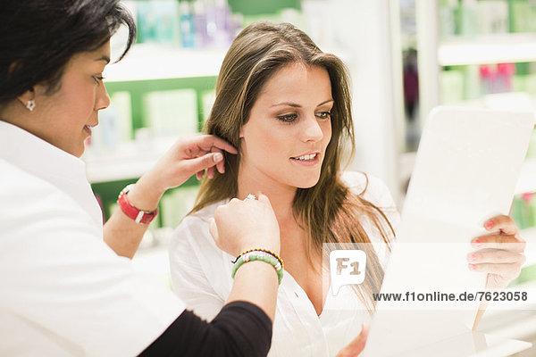 Sales clerk helping customer in store