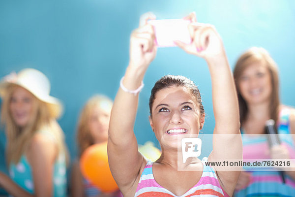 Girl taking picture with cell phone