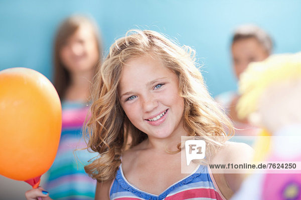 Smiling girl holding balloon
