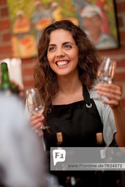 Server taking glass for wine tasting
