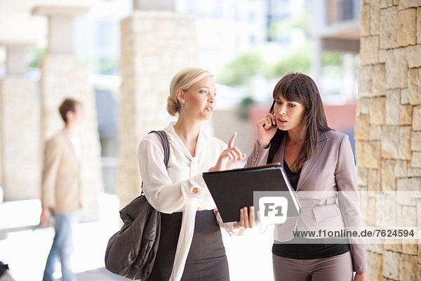 Businesswomen talking in walkway