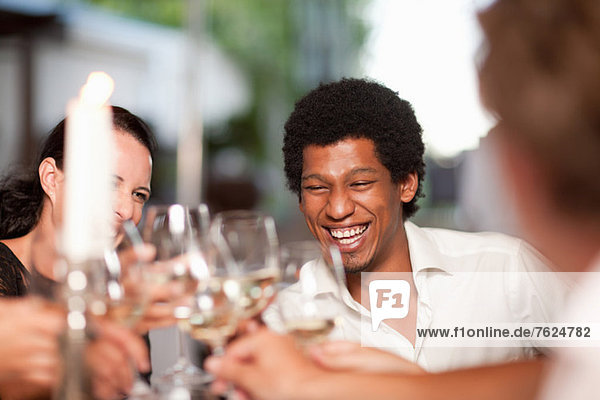 Friends toasting in restaurant