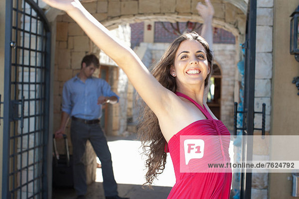 Smiling woman cheering outdoors