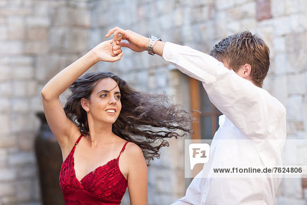 Couple dancing together outdoors