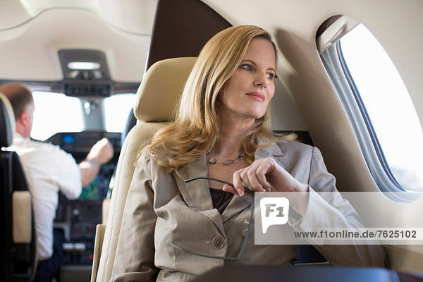 Businesswoman sitting in airplane