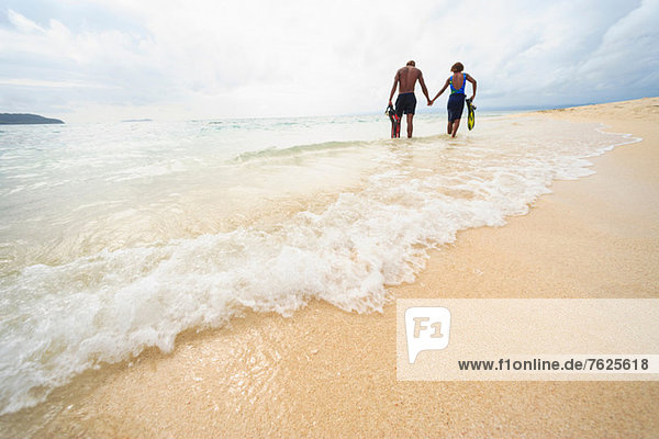 Couple walking on tropical beach