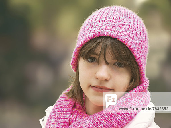 Girl with a pink woolly hat  portrait