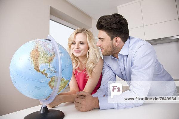 Couple watching globe