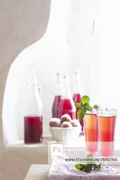 Homemade peach juice with champagne or mineral water