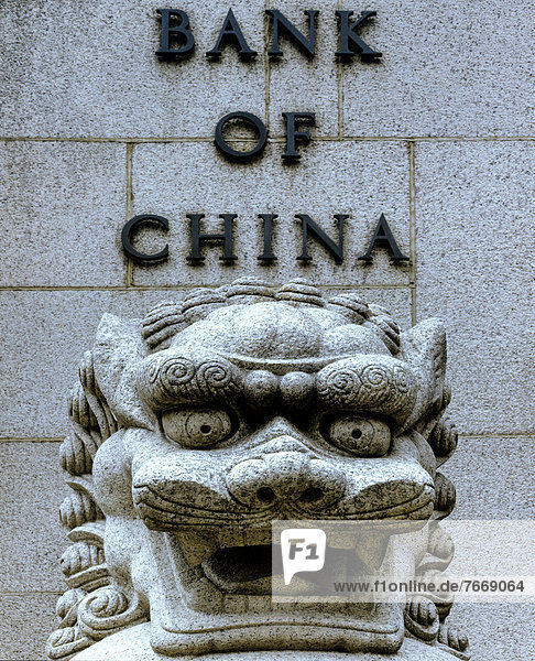 Lion sculpture in stone in front of the Bank of China  Central District  Victoria Island