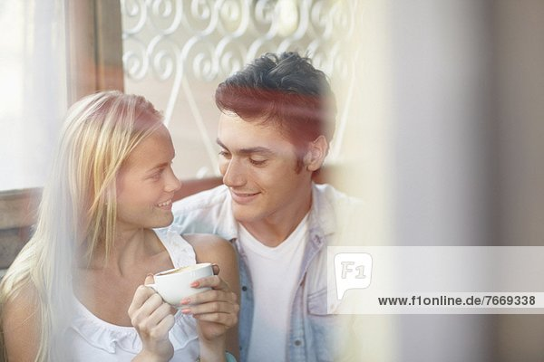 Couple drinking tea in cafe